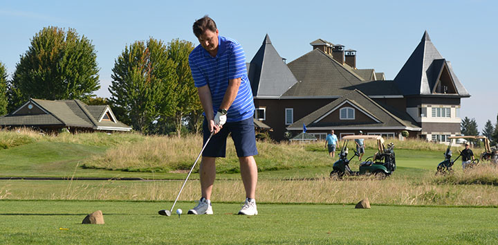 Brian Myers readies his next shot at the 2015 WCCA Golf Tournament.